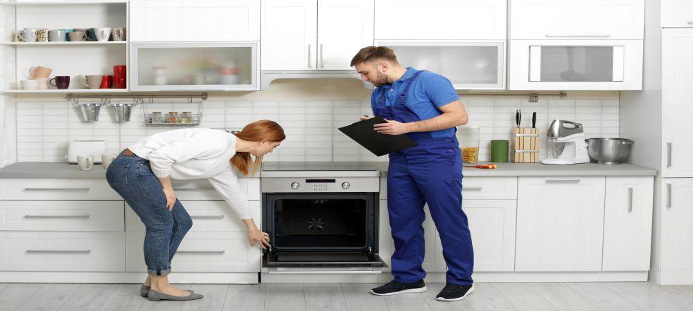 repairman checking oven